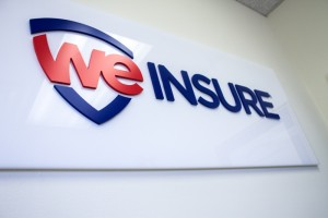 we insure sign in the office
